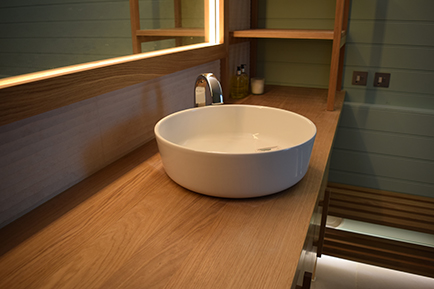Solid Oak worktop to complete the bathroom vanity manufactured by Touch Bespoke Joinery