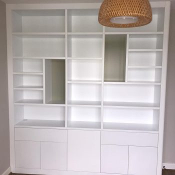 Bookcase with staggered shelving and divisions manufactured by Touch Bespoke Joinery