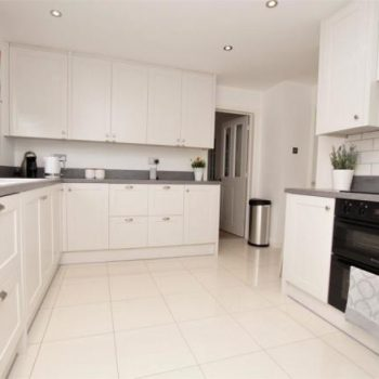 Shaker Kitchen with V groove end panels manufactured by Touch Bespoke Joinery Image 1
