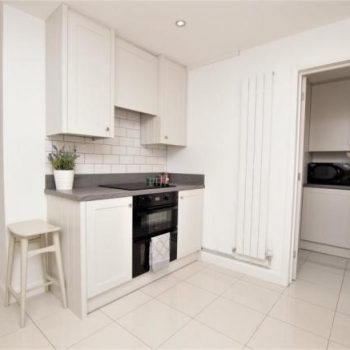 Shaker Kitchen with V groove end panels manufactured by Touch Bespoke Joinery image 4