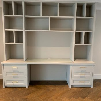 Bespoke home office with bookcase display above