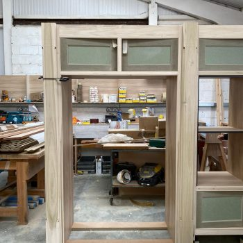 Bespoke kitchen American fridge freezer cabinet with cabinet above being manufactured in the joinery workshop