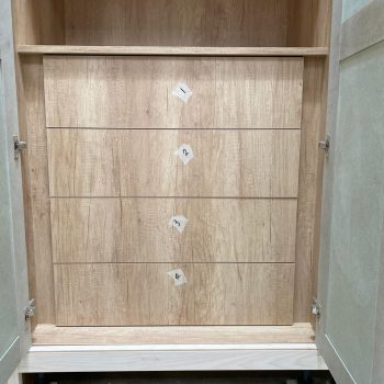 Bespoke Utility room cabinet picture shows a close up image of the book matched drawer fronts using Egger Natural Nebraska Oak