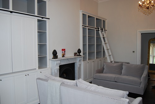 Bespoke Bookcase Concealed Television and Ladder