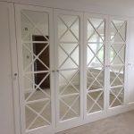 Bespoke Fretwork doors on wardrobe