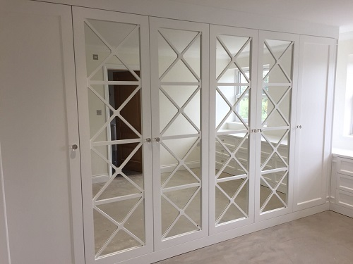 Bespoke Fretwork doors on wardrobe