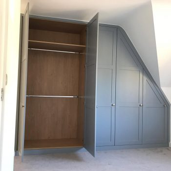 Wardrobes fitted into loft space, Made to suit pitch of roof.