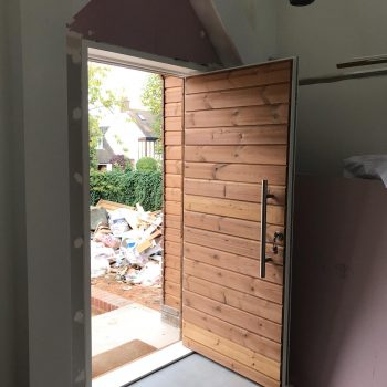 Front Door open with Thermowood Tongue and Groove paneling.