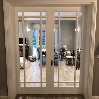 Internal Door and frame with Beveled edge glass.