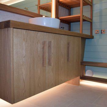 Bespoke changing room joinery, European Oak timber, floating vanity unit