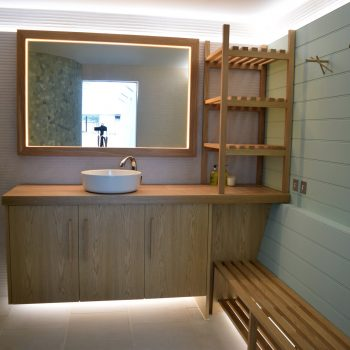 Bespoke Vanity cabinet for changing room of swimming pool area, slatted bench seat and Airing shelves