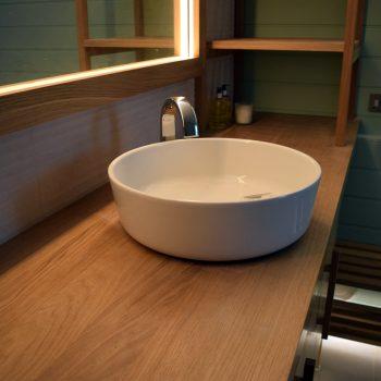 Solid Oak worktop to top of Vanity unit, Bespoke Oak mirror with LED lighting