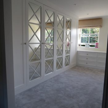 Fretwork doors with X design, silver safety backed mirror to complete bespoke Wardrobes