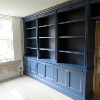 Blue spray painted bookcase made for Home office, cabinets with doors to bottom, open shelving to top