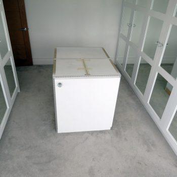 Bespoke walk in wardrobe, island unit waiting to have Granite worktop