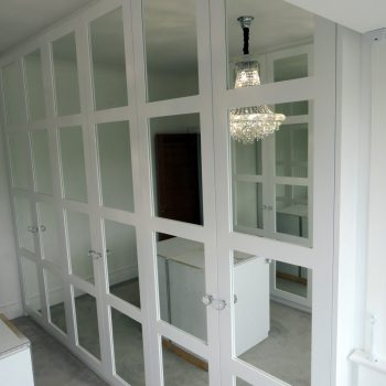 Shaker doors with mirrors between rails, doors and spray painted white, silver safety backed mirrors