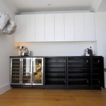 Bespoke bar for home, Black base units and white wall units
