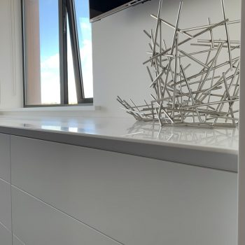 Spray painted worktop with large chamfer to front edge