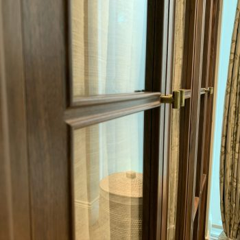 Close up image of Black American Walnut doors with glass panels