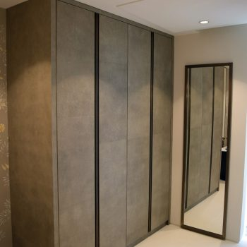 Bespoke wardrobe for the Bathroom, Faux Leather Doors and end panel, Solid Antique Brass Handles