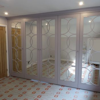 Half moon fretwork doors with silver safety backed mirrors