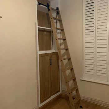 Home office with sliding library ladder, all manufactured from Oak