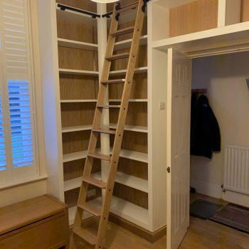 Bespoke home study, Sliding library ladder, black rails, Oak ladder.