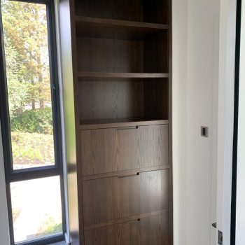 Shelving unit manufactured to conceal manifolds