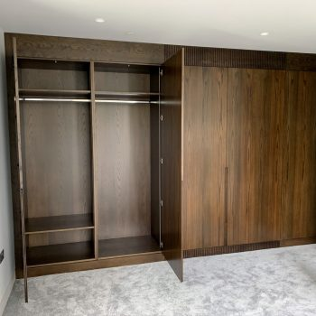 Bespoke wardrobes which also conceal air conditioning unit