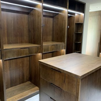 Bespoke Walk in Wardrobe, Island in the middle of the room to allow folding clothes on