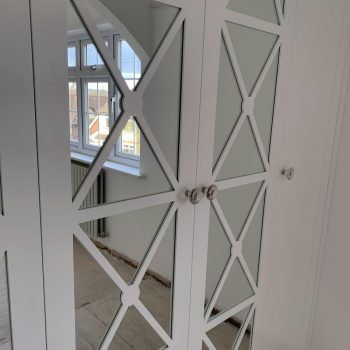 Bespoke Fretwork wardrobe doors with silver safety backed mirror