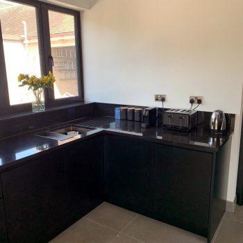 Bespoke hand made kitchen, black doors and worktop