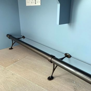 Foot rail fitted underneath home office, bespoke metal work for bespoke joinery