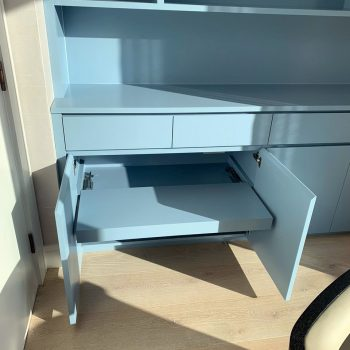 Bespoke cabinet in home office with pull out printer shelf