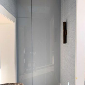 Bespoke storage cabinet in hallway with integrated finger pull detail
