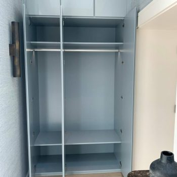 Coat and storage cabinet, doors finished sprayed in High gloss