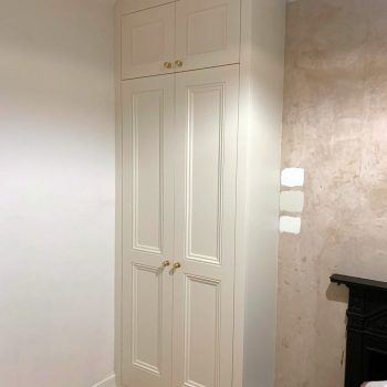 Alcove wardrobe, doors are shaker style with beading to panels