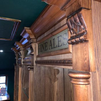 Spoon and dart moulding fitted to a back bar