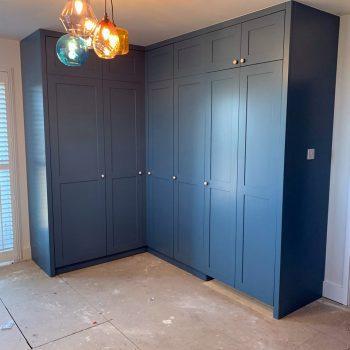L shape wardrobe, shaker doors with secret door to bathroom