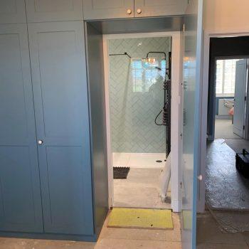 Wardrobe door opened revealing secret entrance to bathroom