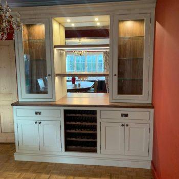 Oak parquet flooring with bespoke wine storage unit