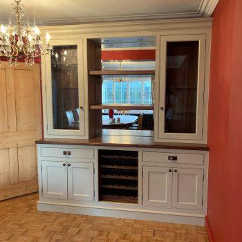 Display cabinet with built in wine racks, Black american walnut and painted doors