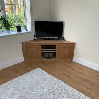 Solid Oak Television Cabinet fitted to a corner of a room