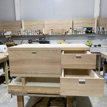 Oak TV unit with pull out drawers and flap down door