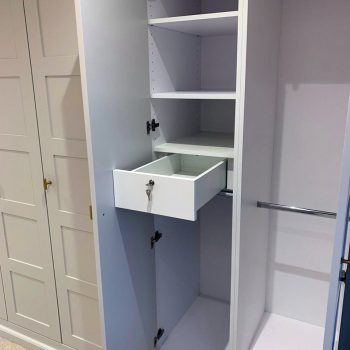Jewellery drawer being opened in a wardrobe