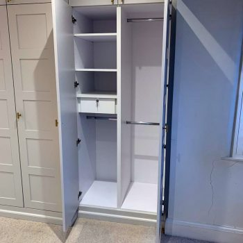 Inside of wardrobe, jewellery box and clothes rails