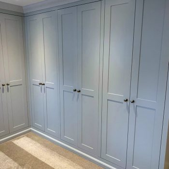 Shaker wardrobe with skirting and coving