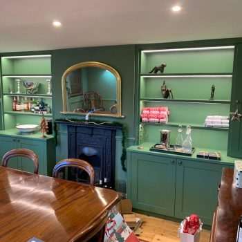 Pair of alcove cabinets finished sprayed green