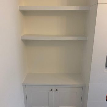 Alcove base cabinet and floating shelves