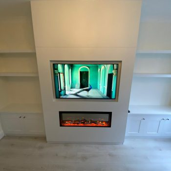 Bespoke alcove units and dummy central fire place to accommodate television and electric fire.
